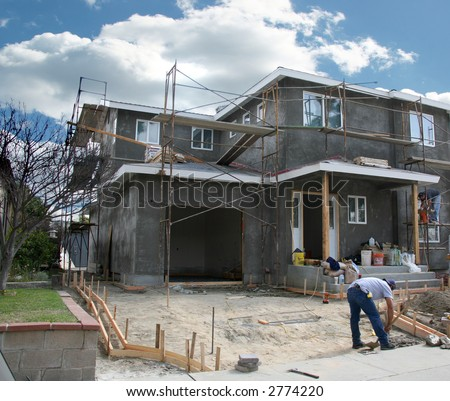 Residential Home Under Construction With Workers on the Job