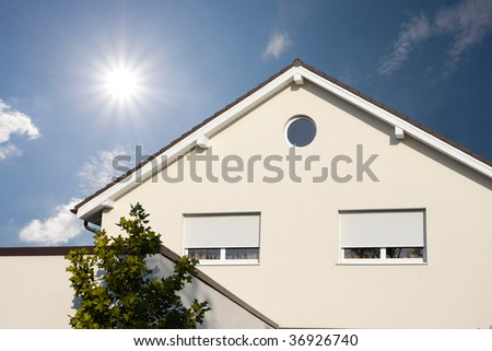 residential house and beautiful clouds - stock photo