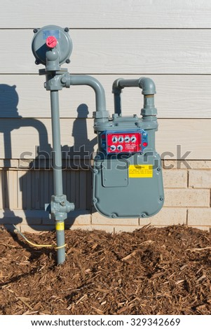 Residential house gas meter - stock photo