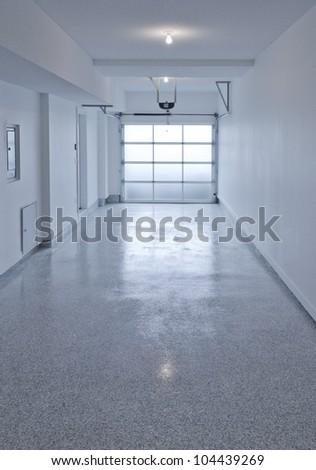 Residential house. Interior of the empty one door garage. - stock photo