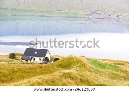 Residential house on the ocean . The Faroe Islands. - stock photo