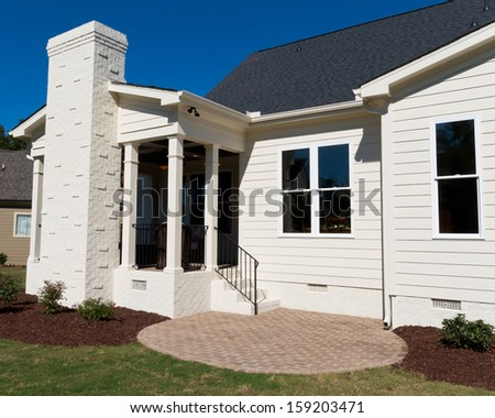 Residential house with backyard porch and patio