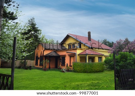 Residential house with green lawn - stock photo