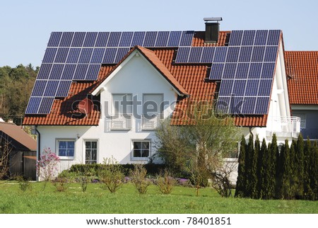 Residential house with photovoltaic installation - stock photo