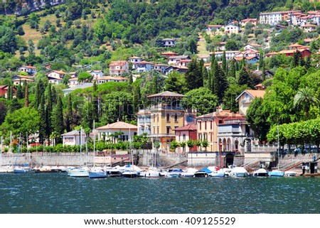 Residential houses and hotels on the coast of Como lake, Tremezzo, Italy. - stock photo