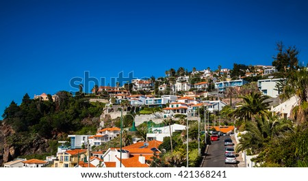residential houses in a small town Canico near Funchal, Madeira, Portugal - stock photo