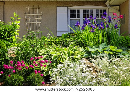 Residential landscaped garden with flowers and plants - stock photo