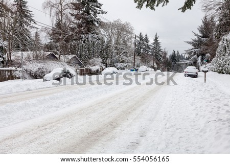 Residential street with abandoned cars after US northwest winter storm.