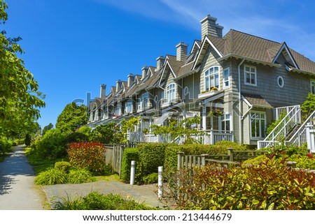 Residential townhouses on sunny day in Vancouver, British Columbia, Canada. - stock photo