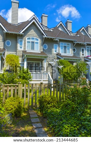Residential townhouses on sunny day in Vancouver, British Columbia, Canada.