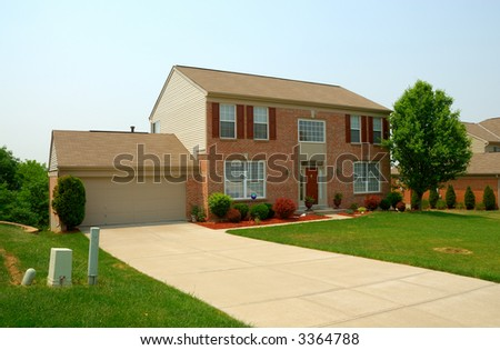 Residential two story brick home in an upscale neighborhood. - stock photo
