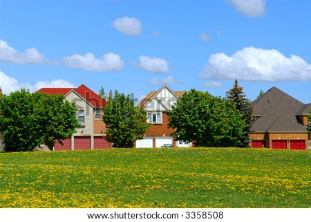 Residential upscale homes with park view in the spring - stock photo