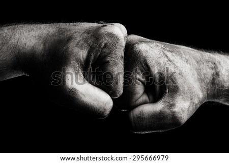 Resistance. Dirty male clenched fist - stock photo
