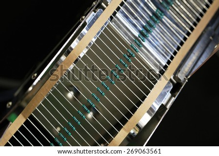 resistors on tape for mounting on printed circuit boards - stock photo