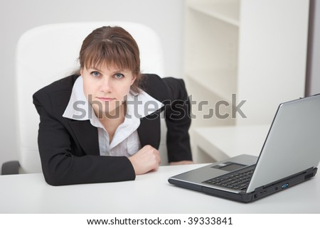 Resolutely woman - the managing director sits at a table with the laptop