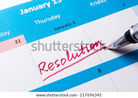 Resolution word written on the calendar with a pen - stock photo