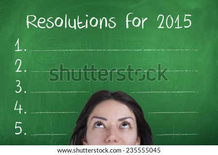 Resolutions for 2015 / New Year Goals List on Blackboard with Girl - stock photo