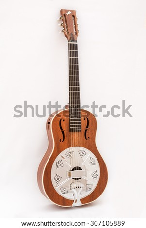 Resonator acoustic guitar made by luthier Luciano Queiroz, Mahogany body. - stock photo