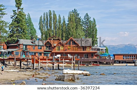 resort along beach in the mountains of north lake tahoe, california, usa - stock photo