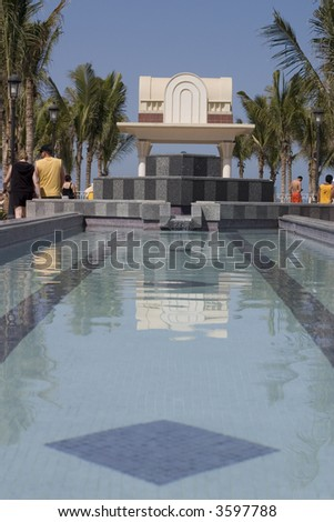 resort fountain and pool - stock photo