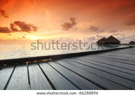 resort maldivian houses - stock photo