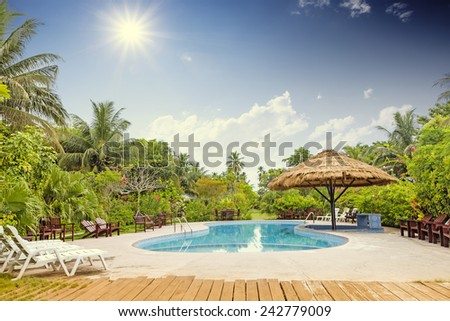 Resort swimming pool with empty plank board  - stock photo