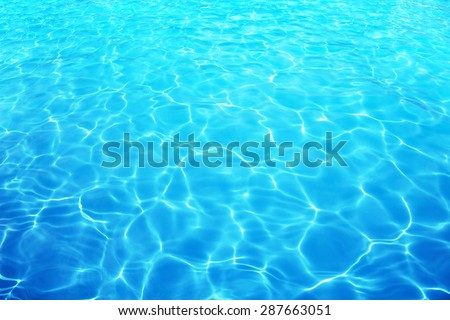 Resort water reflection or water ripple under bright sunny sky.   - stock photo