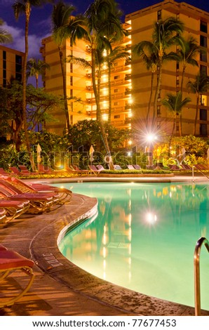 resort with pool at night view - stock photo