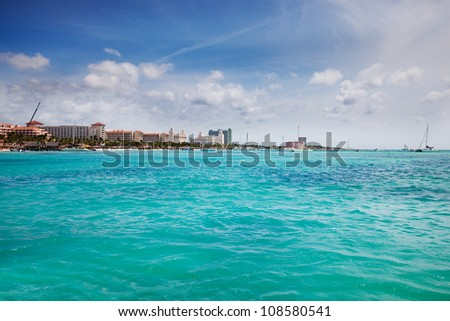 Resorts & hotels line Palm Beach, Aruba on a sunny Spring afternoon - stock photo