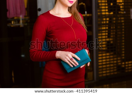 respectable woman holding wallet. Shopping center - stock photo