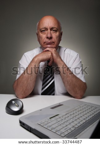 Responsible man with laptop - stock photo