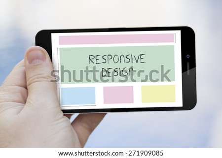 responsive design concept: hand holding a 3d generated smartphone with responsive wireframe on the screen