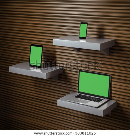 Responsive mockup of a laptop, digital tablet and smart phone on separate shelves. Clipping paths for all displays included. - stock photo