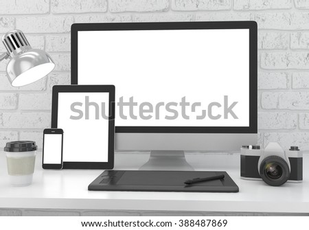 Responsive mockup screen. Monitor, tablet, phone on table in office. - stock photo