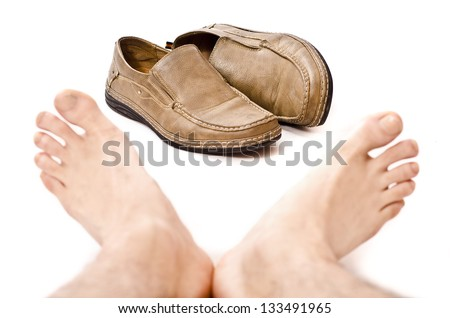 Rest after take off your shoes (isolated on white shoes in focus) - stock photo