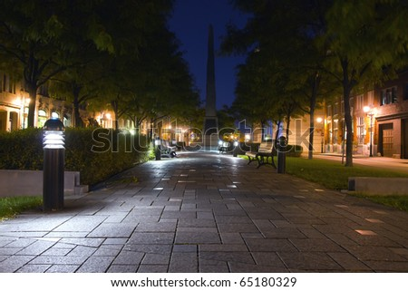 Rest area illuminated in Old Montreal at night - stock photo