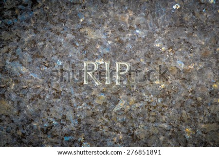 Rest In Peace (RIP) Chiselled Into A Marble Grave In A Cemetery - stock photo