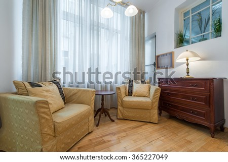 Rest room in home interior , Two big armchairs and dining room is back - stock photo