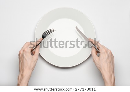 Restaurant and Food theme: the human hand show gesture on an empty white plate on a white background in studio isolated top view - stock photo