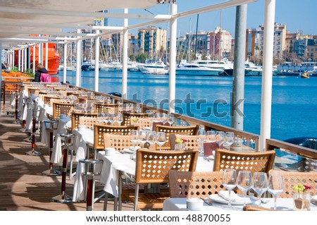 Restaurant at Barcelonas harbour - stock photo