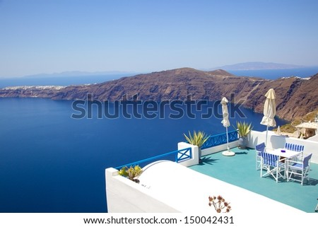 restaurant built above the cliff beside the Aegean sea in Imerovigli town, Santorini, Greece