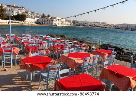 Restaurant by seaside in Mykonos, Greece. - stock photo