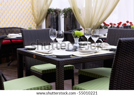 restaurant cafe table, chair, glasses cutlery dish interior