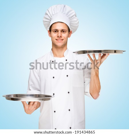 Restaurant chef serving a copy space for menu with prices on a tray. - stock photo