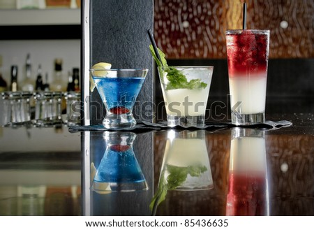 Restaurant Cocktails Lined up on a Marble Bar Top - stock photo