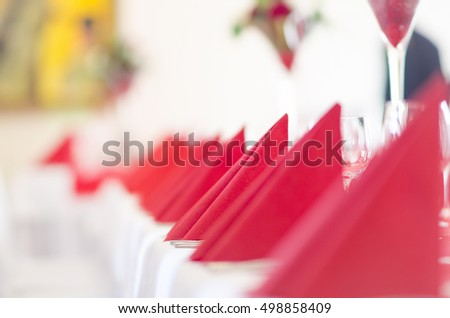 Restaurant decorated with red napkins