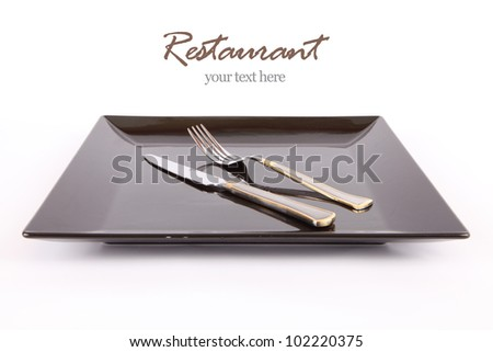 Restaurant Design black Dish with fork and knife, your text here - stock photo