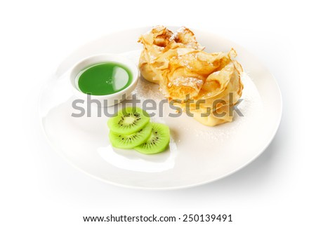 Restaurant food - pancakes with cream cheese filling and kiwi sauce isolated at the white background - stock photo