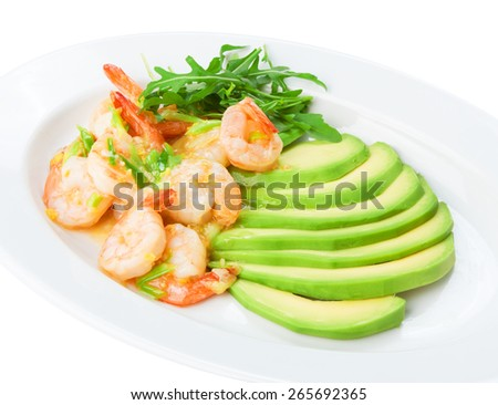 Restaurant food - shrimps in white wine garlic sauce with sliced avocado isolated at the white background - stock photo