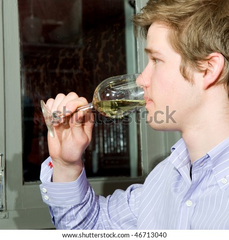 Restaurant guest tasting a glass of white wine - stock photo